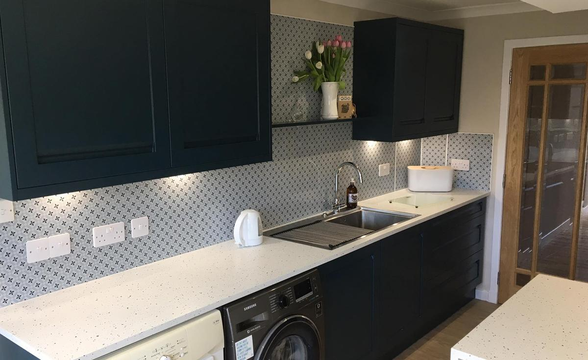 Statement Vista Splashbacks in a Navy Kitchen