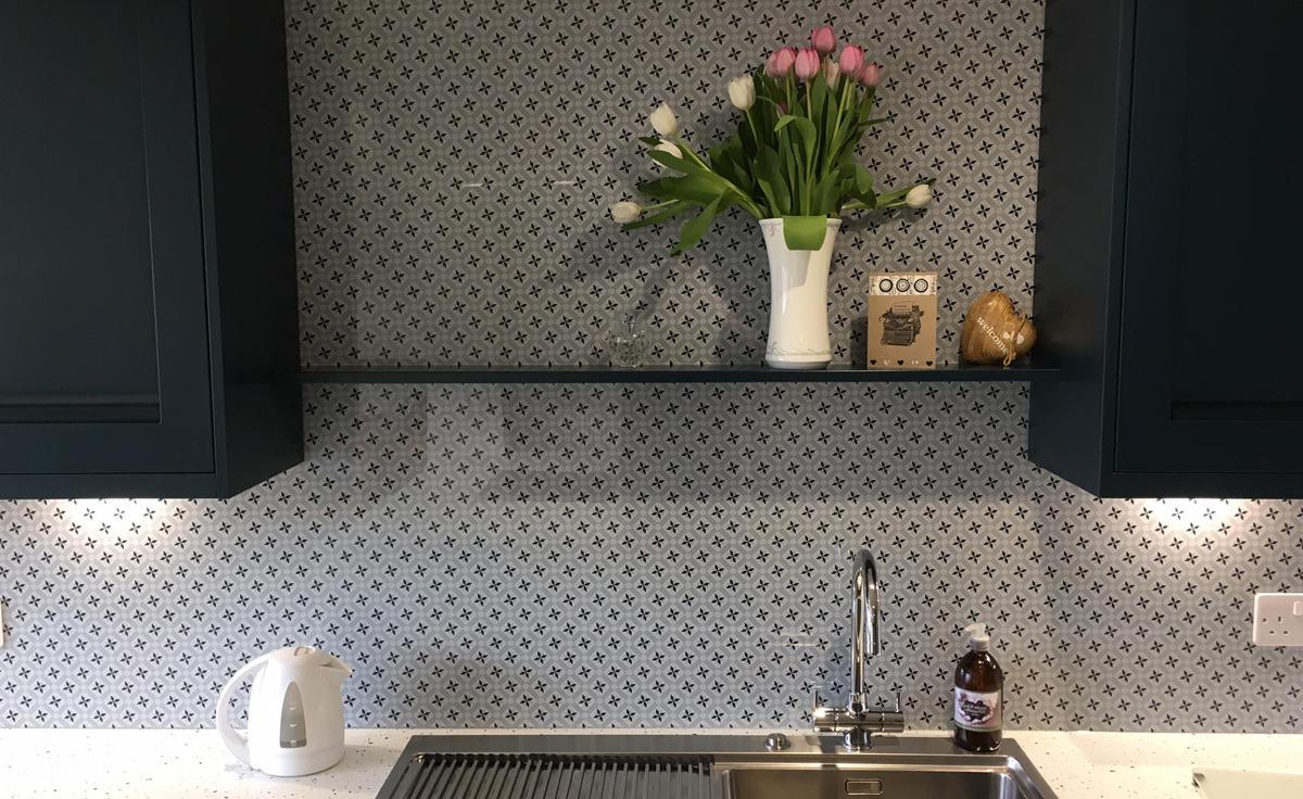 Statement Vista Splashbacks in a Navy Kitchen