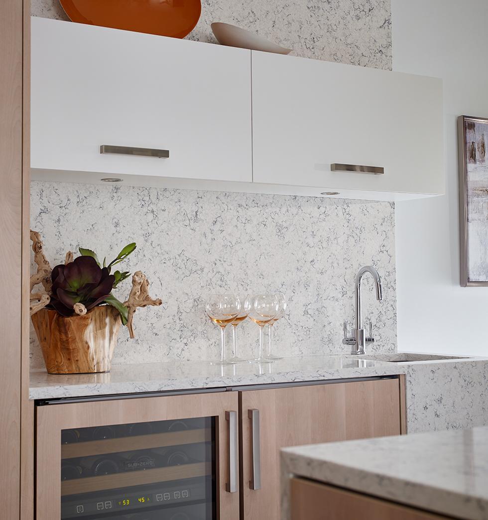 Light Modern Wine Bar with Quartz Countertop and Backsplash