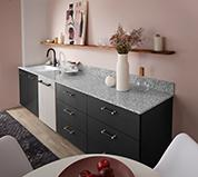 Terrazzo Breakfast Bar with Quartz Countertop and Laminate Cabinet Fronts