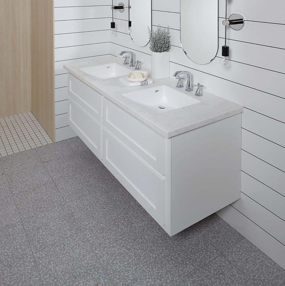 Light and Bright Main Bath with Solid Surface Countertop