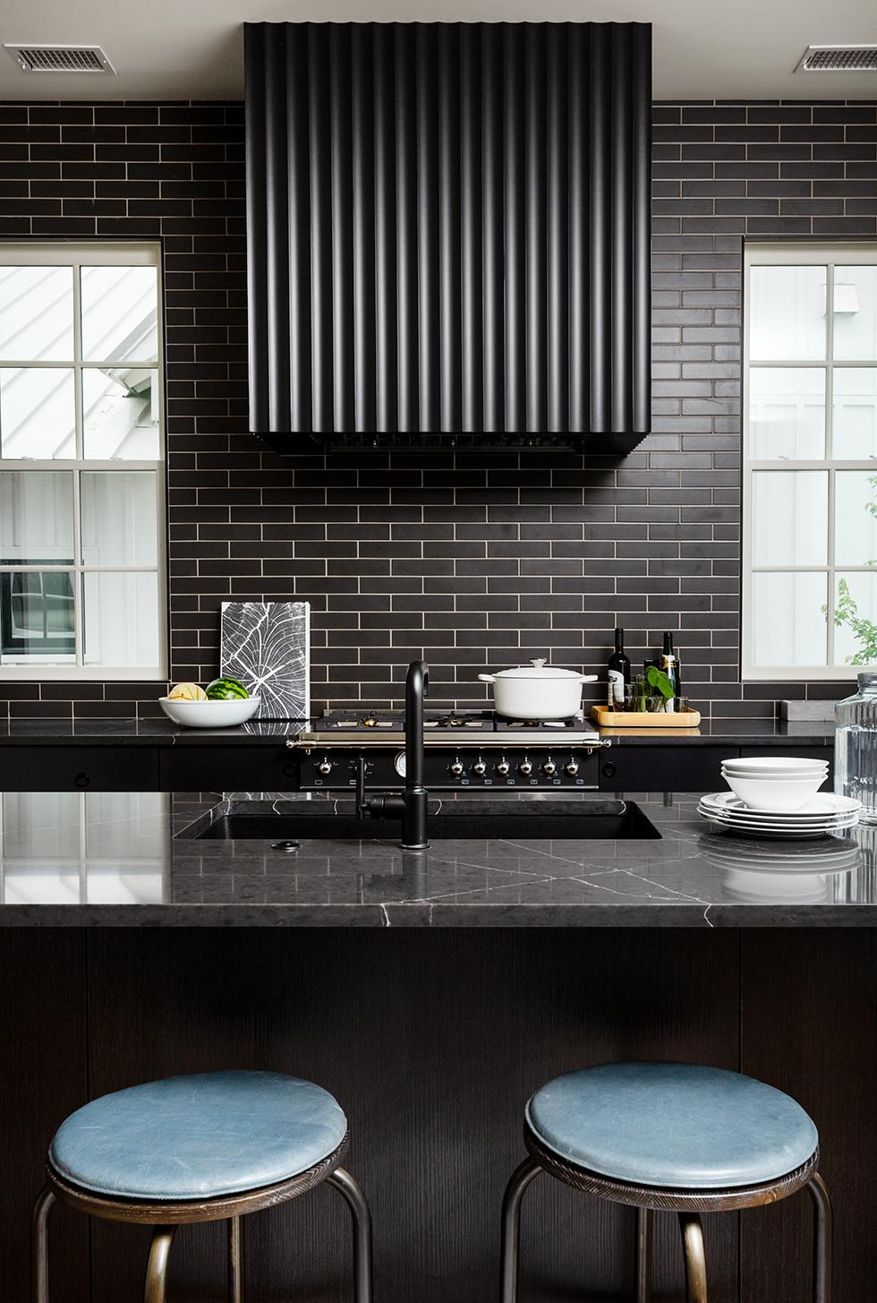 Serenbe House Dark and Dramatic Kitchen with Quartz Countertop